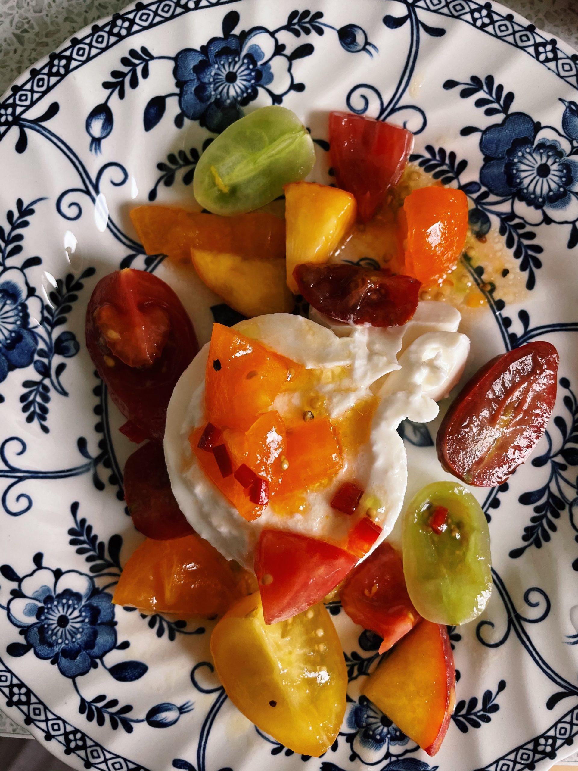 Tomato, burrata and peach salad